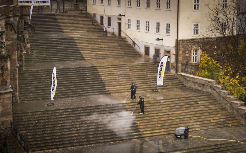 PIC FROM CATERS NEWS -  Two men clean the steps of the Erfurt Cathedral in Germany.