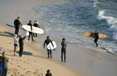 RICHARD KNOPPERT/ CATERS NEWS - The lucky surfers on the beach after the shark sighting Mettams Pool, near North Beach, in Perth, Australia.