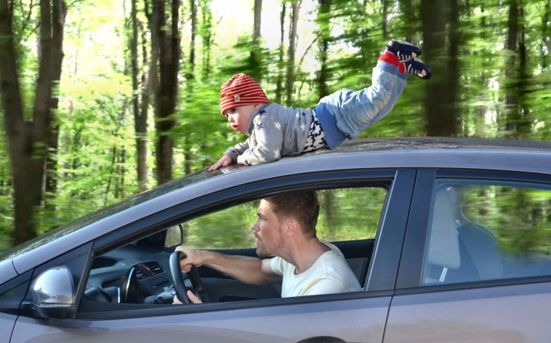 PIC FROM MERCURY PRESS: Andreas Miezans on a car ride with his son during his paternity leave in Tonsberg, Norway.