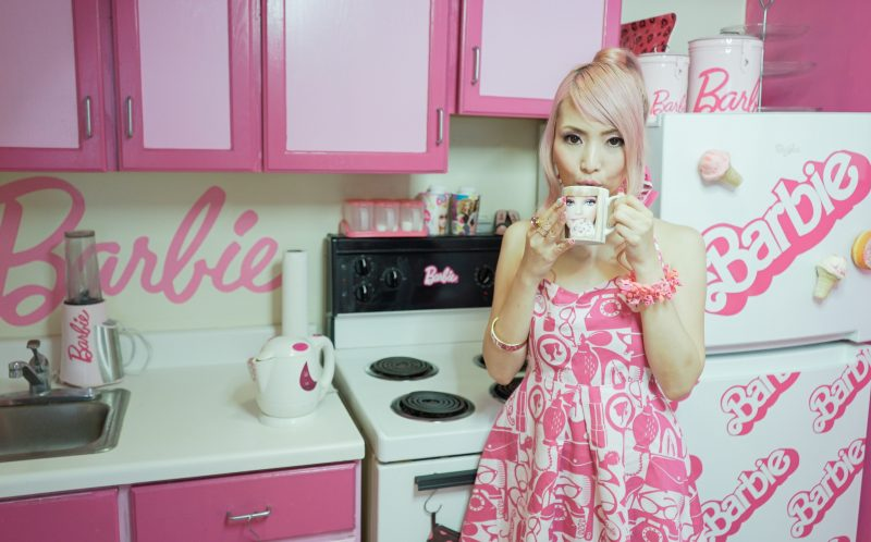 PIC BY CONNOR MURPHY/CATERS NEWS - (PICTURED: Barbie fanatic, Azusa (34), lives in her own Barbie house, complete with Barbie themed kitchen) - Barbies biggest fan has splashed out 55k on her obsession despite being 34 years old. Self-confessed Barbie fanatic, Azusa Sakamoto, from Los Angeles, has forked out 55,000 on her obsession. The nail artist, originally from Japan, fell in love with Barbie after she bought her first Barbie lunchbox when she was just 15. Over the past 20 years, Azusas love for Barbie has spiralled out of control and now everything she owns is Barbie. The huge collection includes 145 dolls, 40 pairs of shoes and 60 bags, and Azusa has spent thousands on Barbie conventions, home furnishings and accessories too. Azusa, who recently dyed her hair pink and goes by the name Azusa Barbie, insists shes not trying to be the doll but simply loves the brand. - SEE CATERS COPY