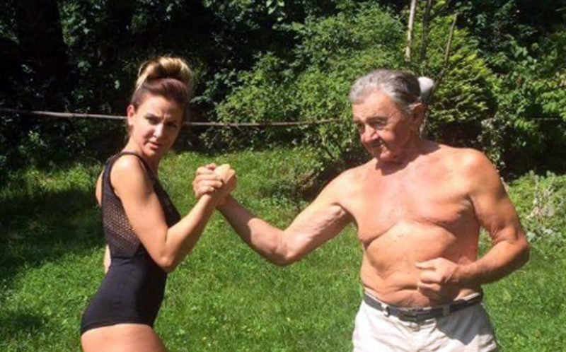 PIC FROM CATERS NEWS - (PICTURED: Basia Kastelik with her grandfather Jan Grzybowski. ) - An 80-year-old grandad has inspired his beautiful granddaughter to become a fitness model after the pair started squatting, weight lifting and running together. Basia Kastelik, 24, fell in love with fitness after her grandad introduced her to his training regime.The now fitness model, trains with her grandad, Jan Grzybowski, 80, every Sunday at their holiday home he built on a picturesque Miedzybrodzie - a village in Poland. Basia, who never used to enjoy exercise, lived in London for four years until summer 2015 but still managed to fly over to visit her grandad most weekends. Their workouts now consist of weight lifting, squats, running and cycling together. And thanks to her new training partner, Jan, Basia is now a fitness model after gaining herself a six pack and perfect muscle tone. SEE CATERS COPY.