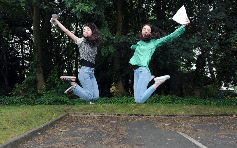 PIC BY KORAY EROL/ CATERS NEWS - (PICTURED: L-R Masa and Aya Shannout, both 18 jumping for jopy with their A level results) - Talk about seeing double! These identical twins have got incredible identical A Level results and now theyre off to the same uni to do IDENTICAL courses. Masa and Aya Shannout, both 18, were over-the-moon with their amazing matching results with both of them getting an A in maths and A* in biology and chemistry at Camp Hill Girls School, in Birmingham, West Mids. Now the undistinguishable due are both off to University of Birmingham in September to study dentistry. SEE CATERS COPY.