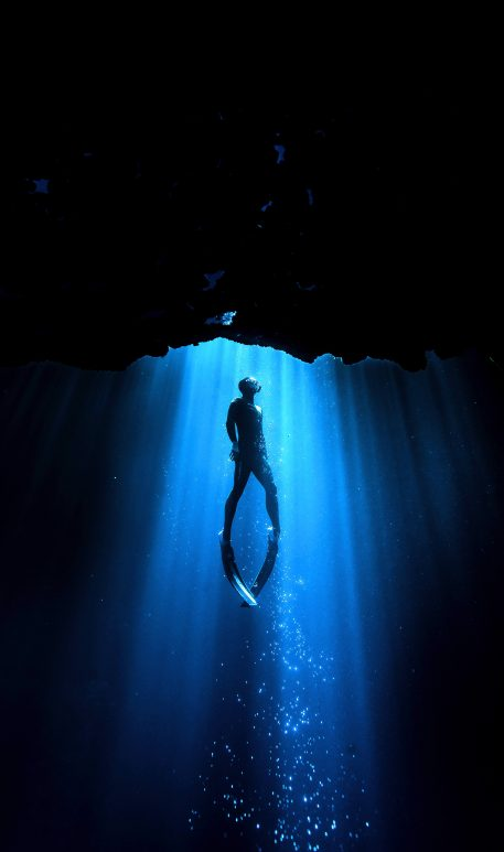 PIC BY ALASTAIR SCARLETT/CATERS NEWS - (PICTURED: A diver swimming in the Blue Hole in Gozo. ) - Beam me up! This spooky underwater glow makes divers look like they are being beamed up by ALIENS. As a chink of eerie green light beams down deep into the ocean, the divers in the water look like theyre being summoned by extra-terrestrials. The series of mystical snaps was taken by underwater photographer Alastair Scarlett, from Newquay, Cornwall, during trips to Gozo, the Maldives and Mexico. Alastair, 38, who works as a printer at a garment decoration company, said: Each dive is different, depending on the conditions and depth. SEE CATERS COPY.