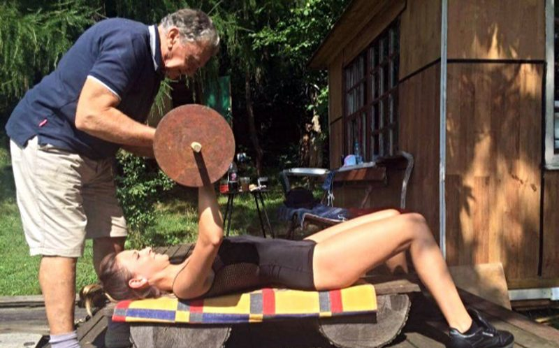 PIC FROM CATERS NEWS - (PICTURED: Basia Kastelik works out with her grandfather Jan Grzybowski. ) - An 80-year-old grandad has inspired his beautiful granddaughter to become a fitness model after the pair started squatting, weight lifting and running together. Basia Kastelik, 24, fell in love with fitness after her grandad introduced her to his training regime.The now fitness model, trains with her grandad, Jan Grzybowski, 80, every Sunday at their holiday home he built on a picturesque Miedzybrodzie - a village in Poland. Basia, who never used to enjoy exercise, lived in London for four years until summer 2015 but still managed to fly over to visit her grandad most weekends. Their workouts now consist of weight lifting, squats, running and cycling together. And thanks to her new training partner, Jan, Basia is now a fitness model after gaining herself a six pack and perfect muscle tone. SEE CATERS COPY.