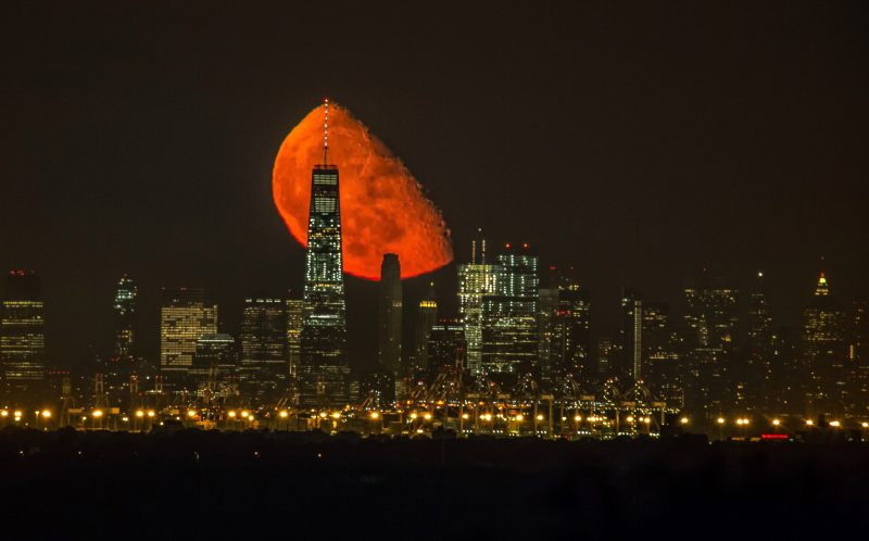 Moon Rises Over Trade Centre In Manhattan Caters News Agency