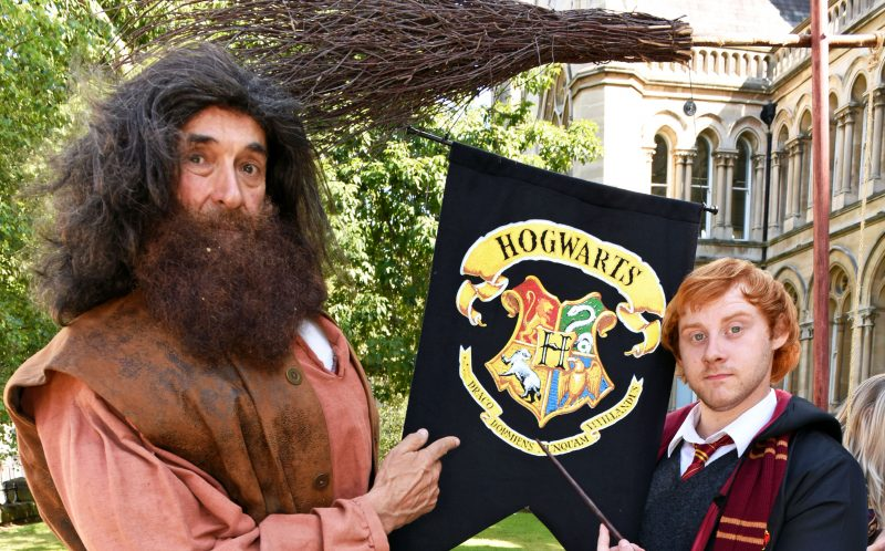 PIC BY KORAY EROL/CATERS NEWS - (PICTURED: Edmond Wells as Hagrid and Lewis Parker as Ron Weasley.) - Seeing double? Red head Lewis Parker reckons hes the UKs best Ron Weasley lookalike - and charges up to 1000 a time for appearances. Lewis, 25, can charge four-figure sums to appear at Harry Potter conventions - and says that since the release of Harry Potter and the Cursed Child, his bookings have skyrocketed. Lewis, from Holbeach, Lincs, has spent almost a decade working as a marble mason - but is hoping to become a full-time Ron Weasley impersonator after he began working as a lookalike last year - despite being more than a decade older than Ron. SEE CATERS COPY.