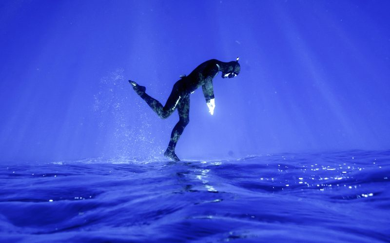 PIC BY ALASTAIR SCARLETT/CATERS NEWS - (PICTURED: A shot of a diver appearing to dive while walking on water in Gozo. ) - Beam me up! This spooky underwater glow makes divers look like they are being beamed up by ALIENS. As a chink of eerie green light beams down deep into the ocean, the divers in the water look like theyre being summoned by extra-terrestrials. The series of mystical snaps was taken by underwater photographer Alastair Scarlett, from Newquay, Cornwall, during trips to Gozo, the Maldives and Mexico. Alastair, 38, who works as a printer at a garment decoration company, said: Each dive is different, depending on the conditions and depth. SEE CATERS COPY.