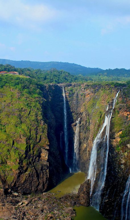 PIC BY TAPAS CHATTOPADHYAY/CATERS NEWS - (PICTURED: A rainbow appears in Indias second largest waterfall in Karnataka, India.) - This breathtaking picture captures the moment a rainbow appeared out of a waterfall. The phenomenon was photographed by civil engineer Tapas Chattopadhyay in Karnatakam India. Tapas, who was enjoying the view from the top of the waterfall, trekked all the way down to see the rainbow in all its glory at Indias second largest waterfall.The 43-year-old descended all 253 metres of the waterfall - and unsurprisingly got soaked as he neared the spectrum. SEE CATERS COPY.