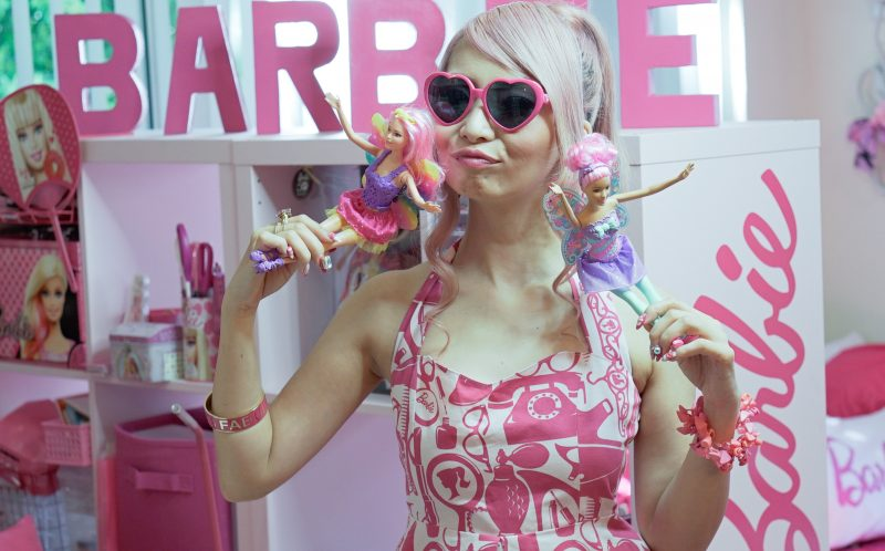 PIC BY CONNOR MURPHY/CATERS NEWS - (PICTURED: Surrounded by Brabie memorabilia, Azusa Sakamoto is possibly Barbies biggest fan.) - Barbies biggest fan has splashed out 55k on her obsession despite being 34 years old. Self-confessed Barbie fanatic, Azusa Sakamoto, from Los Angeles, has forked out 55,000 on her obsession. The nail artist, originally from Japan, fell in love with Barbie after she bought her first Barbie lunchbox when she was just 15. Over the past 20 years, Azusas love for Barbie has spiralled out of control and now everything she owns is Barbie. The huge collection includes 145 dolls, 40 pairs of shoes and 60 bags, and Azusa has spent thousands on Barbie conventions, home furnishings and accessories too. Azusa, who recently dyed her hair pink and goes by the name Azusa Barbie, insists shes not trying to be the doll but simply loves the brand. - SEE CATERS COPY