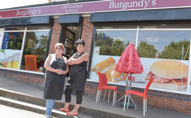 PIC BY MICHAEL SCOTT/CATERS NEWS - (PICTURED: (L-R) Shop Manager, stephanie Davidson (60) and Shop Co-Owner, Pat Cresswell (58) outside the Burgundys cafe that was broken into on Sunday evening.)- Brazen burglars smashed through three BRICK WALLS to steal a stash of cigarettes.The thieves broke into Burgundys in Basford, Nottingham, on Sunday evening and made off with the load worth 6 thousand pounds. It took them just 40 seconds to clear the newsagents-cum-cafe of its cigarette stock around 11.10pm on Sunday 14 August. But it wasnt until owner Pat Cresswell, 58, opened up that she realised theyd been broken in to - and saw the burglars had neatly stacked the bricks they took out of the wall. SEE CATERS COPY.