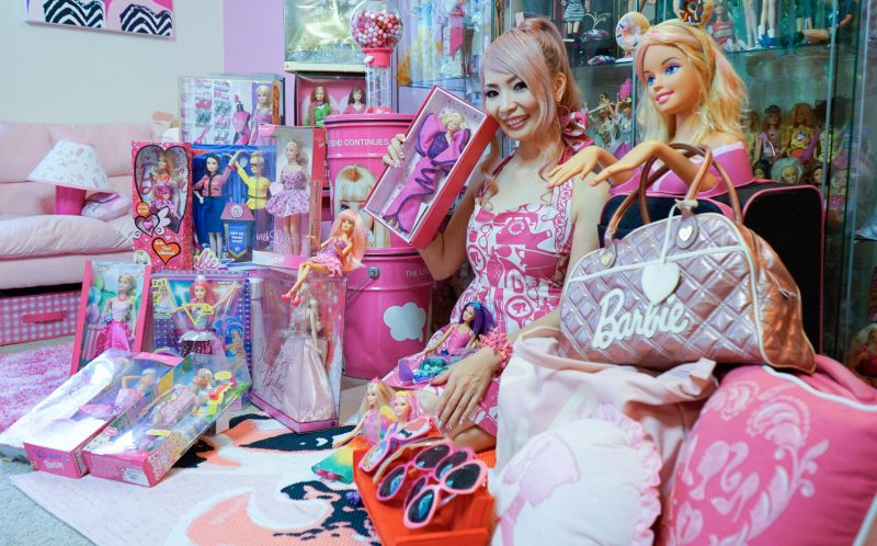 PIC BY CONNOR MURPHY/CATERS NEWS - (PICTURED: Azusa Sakamoto (34) from Los Angeles is surrounded by her mega collection of Barbie memorabilia.) - Barbies biggest fan has splashed out 55k on her obsession despite being 34 years old. Self-confessed Barbie fanatic, Azusa Sakamoto, from Los Angeles, has forked out 55,000 on her obsession. The nail artist, originally from Japan, fell in love with Barbie after she bought her first Barbie lunchbox when she was just 15. Over the past 20 years, Azusas love for Barbie has spiralled out of control and now everything she owns is Barbie. The huge collection includes 145 dolls, 40 pairs of shoes and 60 bags, and Azusa has spent thousands on Barbie conventions, home furnishings and accessories too. Azusa, who recently dyed her hair pink and goes by the name Azusa Barbie, insists shes not trying to be the doll but simply loves the brand. - SEE CATERS COPY