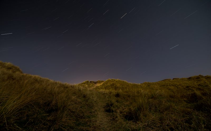 PIC BY JACK SARGENT / CATERS NEWS - (PICTURED: The beautiful night sky at Jurassic Coast captured by Jack Sargent.) - As if this beach was not stunning enough- a meteor on top of the milky way brightening up the sky took it to a whole new level of beauty. When it was announced last week that we would be treated to a meteor shower, there was only one place Coleford bricklayer, Jack Sargent was heading. Jack, 22 from Gloucestershire made the trip down to the Jurassic coast on August 11 where he captured the meteors soaring past up above. SEE CATERS COPY.