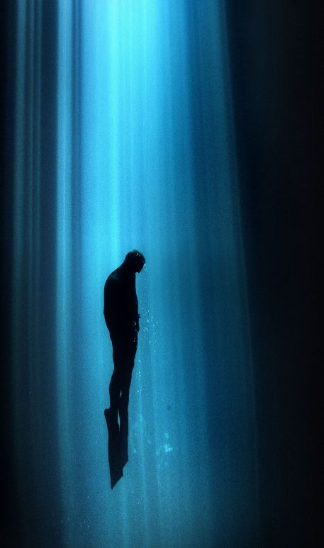 PIC BY ALASTAIR SCARLETT/CATERS NEWS - (PICTURED: A diver swims in a beam of light shining from above near Mexico.) - Beam me up! This spooky underwater glow makes divers look like they are being beamed up by ALIENS. As a chink of eerie green light beams down deep into the ocean, the divers in the water look like theyre being summoned by extra-terrestrials. The series of mystical snaps was taken by underwater photographer Alastair Scarlett, from Newquay, Cornwall, during trips to Gozo, the Maldives and Mexico. Alastair, 38, who works as a printer at a garment decoration company, said: Each dive is different, depending on the conditions and depth. SEE CATERS COPY.