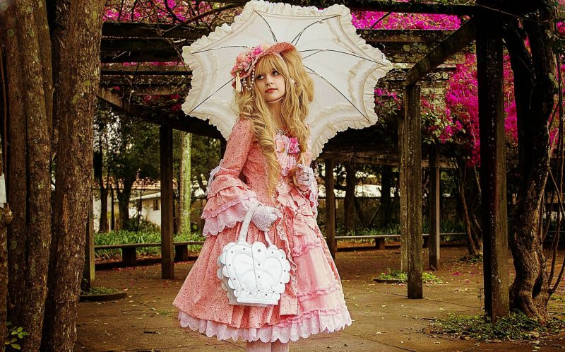 PICS BY MEDORE RUIZ / CATERS NEWS - (PICTURED: Here is the dress that took Medore, her grandmother and sisters two years to complete - between other work - she says its her favourite and takes her back to her childhood) - Meet the student who is splashing more than 0k a year so that she can live as a real life Victorian doll. Medora Ruiz, 22, from Sao Paolo, Brazil, became obsessed with the dresses, bows and hats worn by her favourite childhood dolls  and now lives just like one every day. She started making her own dresses eight years ago and now has more than 20 dresses, each one can take between two weeks and two years to make. The student says she spends in excess of 0,000 a year sourcing material, accessories and travelling to buy items for her unusual hobby. For conventions it can take Medora up to three hours to get ready in her Victorian-era inspired clothing and up to an hour on a normal day. Her eccentric attire attracts a lot of attention, with her claiming that children arent able to tell if shes really a doll or a human, as well as regularly being asked out on dates by strangers. She believes after dressing as a real life human doll for two years now that she would struggle to return to wearing normal clothing. - SEE CATERS COPY