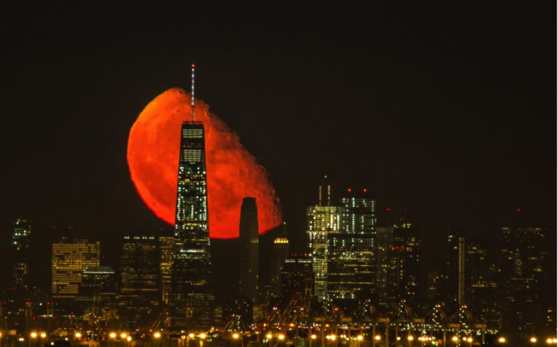 *** MANDATORY BYLINE PIC BY JENNIFER KHORDI/ CATERS NEWS - (PICTURED: An incredible moon rise behind the World Trade Center, Manhattan, New York) - In this Mars in Manhattan? Youd be forgiven for mistaking the moon for the red planet in these striking images of the New York skyline. The breath-taking photo was taken by photographer Jennifer Khordi. Jennifer, who is from New Jersey, captured the images last night. She said: it was just absolutely amazing to see this. END.