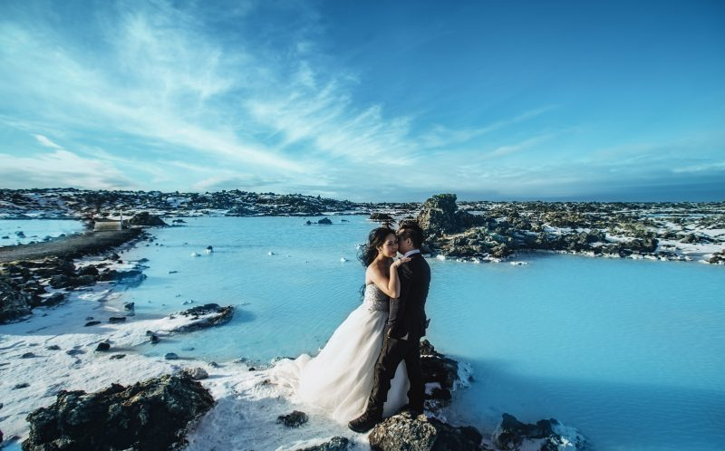 **PLEASE NOTE MANDATORY BYLINE** PIC BY LIFE STUDIOS / CATERS NEWS - (PICTURED: Cici Wu and fiance, Clement Ng pose for their engagement photos in Iceland.) - A loved-up couple announced their engagement with these brr-illiant photos - taken on a GLACIER. Cici Wu and Clement Ng jetted off to Iceland for the unique photoshoot, which also saw them pose on a volcano and next to a waterfall. The cool couple spent five days in the icy climes getting their perfect photograph after enlisting the help of cinematographer Jacob Wasef. Vancouver-based Jacob, Creative Director at Life Studios Inc, said it was an exhilarating but challenging shoot, with temperamental weather conditions and tricky locations pushing the couple to their limits. SEE CATERS COPY.