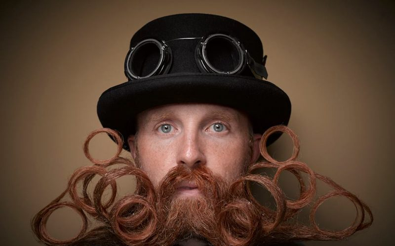 PIC BY GREG ANDERSON / CATERS NEWS - (PICTURED: Garey Faulkner.) - Gents from around the world descended on Nashville earlier this month fighting for the title of best beard in the National Beard and Moustache Championship. The annual competition covers 17 categories in which the men can compete, ranging from freestyle, to natural, to facial hair inspired by icons such as Dali and the Musketeers. With the competition as stiff as the waxed moustaches, competitors had to go beard to beard to decide whose facial fuzz was the most fan-TASH-tic. Competitors were judged on their overall appearance, style and personality, with judges also considering originality and creativity in the freestyle categories. Contestants certainly rose to the challenge with perfectly curled beards and also more outrageous statement styles, such as a Tim Burton themed beard, and a beard styled to look like a beak. - SEE CATERS COPY
