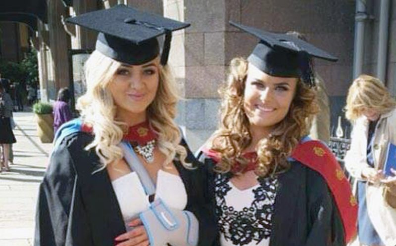 PIC FROM CATERS NEWS - (PICTURED: Bekkie (L) with a friend during graduation.) - Paramedics feared a student who was millimetres from death had been DECAPITATED after a terrifying car crash. Bekkie Payne, from Wombourne, Staffordshire, is still on morphine 18 months on from the horror smash which put her in hospital for seven weeks. Bekkie, 23, was driving round a roundabout when her car clipped the kerb, sending her Fiat Punto crashing through a wooden fence into a ditch where it then set on fire. A fence panel severed her neck after coming through the windscreen and was just millimetres from a vital artery, with paramedics worrying she had been decapitated. The life-changing accident also left the criminology student with a brain injury, a paralysed left arm, a fractured collarbone, a chipped spine and heavy bruising to her face. SEE CATERS COPY.