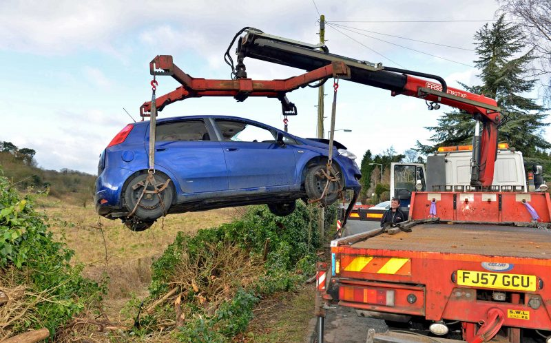 PIC FROM EXPRESS AND STAR/CATERS NEWS - (PICTURED: Bekkies car as it was being taken out of the ditched where she crashed. ) - Paramedics feared a student who was millimetres from death had been DECAPITATED after a terrifying car crash. Bekkie Payne, from Wombourne, Staffordshire, is still on morphine 18 months on from the horror smash which put her in hospital for seven weeks. Bekkie, 23, was driving round a roundabout when her car clipped the kerb, sending her Fiat Punto crashing through a wooden fence into a ditch where it then set on fire. A fence panel severed her neck after coming through the windscreen and was just millimetres from a vital artery, with paramedics worrying she had been decapitated. The life-changing accident also left the criminology student with a brain injury, a paralysed left arm, a fractured collarbone, a chipped spine and heavy bruising to her face. SEE CATERS COPY.
