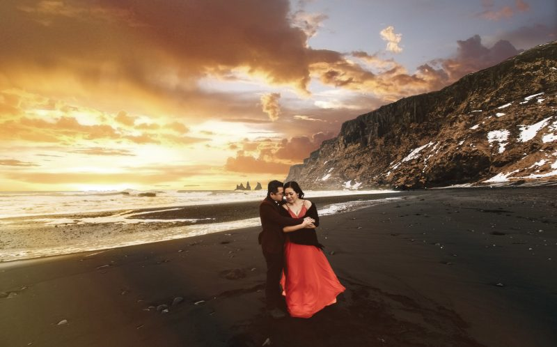 **PLEASE NOTE MANDATORY BYLINE** PIC BY LIFE STUDIOS / CATERS NEWS - (PICTURED: Cici and Clement pose on a beach in Iceland. ) - A loved-up couple announced their engagement with these brr-illiant photos - taken on a GLACIER. Cici Wu and Clement Ng jetted off to Iceland for the unique photoshoot, which also saw them pose on a volcano and next to a waterfall. The cool couple spent five days in the icy climes getting their perfect photograph after enlisting the help of cinematographer Jacob Wasef. Vancouver-based Jacob, Creative Director at Life Studios Inc, said it was an exhilarating but challenging shoot, with temperamental weather conditions and tricky locations pushing the couple to their limits. SEE CATERS COPY.