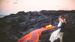 PIC BY JENNA LEE/ CATERS NEWS - (PICTURED: Lauren and Alex during their wedding shoot) - This scene gives an entirely new meaning to a Red Wedding  as a couple celebrated tying the knot in front of a LAVA FLOW! Childhood sweethearts Lauren and Alexander Michaels hiked four miles in the middle of the night with friend and photographer Jenna Lee for a romantic dawn shoot. On the slopes of the Kilauea volcano in Hawaii the fiery lava provided the perfect backdrop for the sizzling love snaps. Jenna, the 31-year-old owner from Jenna Lee Pictures, knows the couple well from her time working on other peoples weddings with Lauren. SEE CATERS COPY.