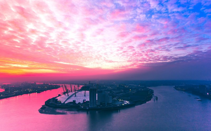 PIC BY LUKAS SPENCER/ CATERS NEWS - (PICTURED: Lukas Spencer shoots a stunning sunset overlooking the former millennium dome now the 02 arena in London, UK. ) -  These images of London at night arent your regular skyline shots - rather than taking photos of the skyline, Lukas Spencer takes photos FROM the skyline. Over the past year, Lukas has been exploring the capital by night to capture these amazing and unique images. Lukas, who is originally from Coventry, West Mids, discovered his love for rooftop photography five years ago and is now part of a team of explorers and photographers who explore and shoot across the world. SEE CATERS COPY.