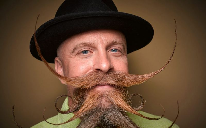 PIC BY GREG ANDERSON / CATERS NEWS - (PICTURED: James McMahon.) - Gents from around the world descended on Nashville earlier this month fighting for the title of best beard in the National Beard and Moustache Championship. The annual competition covers 17 categories in which the men can compete, ranging from freestyle, to natural, to facial hair inspired by icons such as Dali and the Musketeers. With the competition as stiff as the waxed moustaches, competitors had to go beard to beard to decide whose facial fuzz was the most fan-TASH-tic. Competitors were judged on their overall appearance, style and personality, with judges also considering originality and creativity in the freestyle categories. Contestants certainly rose to the challenge with perfectly curled beards and also more outrageous statement styles, such as a Tim Burton themed beard, and a beard styled to look like a beak. - SEE CATERS COPY