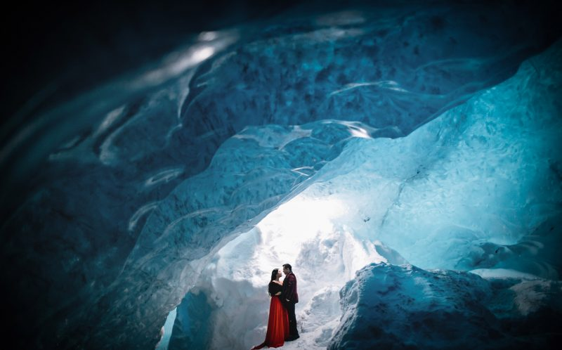 **PLEASE NOTE MANDATORY BYLINE** PIC BY LIFE STUDIOS / CATERS NEWS - (PICTURED: Cici Wu and Clement Ng pose inside an ice cave for their engagement photos. ) - A loved-up couple announced their engagement with these brr-illiant photos - taken on a GLACIER. Cici Wu and Clement Ng jetted off to Iceland for the unique photoshoot, which also saw them pose on a volcano and next to a waterfall. The cool couple spent five days in the icy climes getting their perfect photograph after enlisting the help of cinematographer Jacob Wasef. Vancouver-based Jacob, Creative Director at Life Studios Inc, said it was an exhilarating but challenging shoot, with temperamental weather conditions and tricky locations pushing the couple to their limits. SEE CATERS COPY.