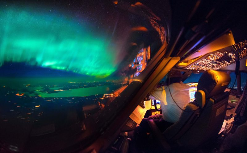 PIC BY CHRISTANN VAN HEIJST AND DAANS KRANS/CATERS NEWS - (PICTURED: A view of the cockpit with the Northern Lights blanketing the windscreen.) - This is truly heavenly weather  as pictures taken from an airplane cockpit reveal what pilots see from above. It looks like at cruising altitude the weather really hots up, with the flight deck revealing some amazing scenes. Thunderstorms light up the insides of clouds, lightening streaks across the sky like cracks in a windscreen, the northern lights sweep uninterrupted across the sky and the galaxy stretches on forever. The pictures were captured by senior first officer Christiaan van Heijst, a 33-year-old from the Netherlands, and his friend Daan Krans. SEE CATERS COPY.