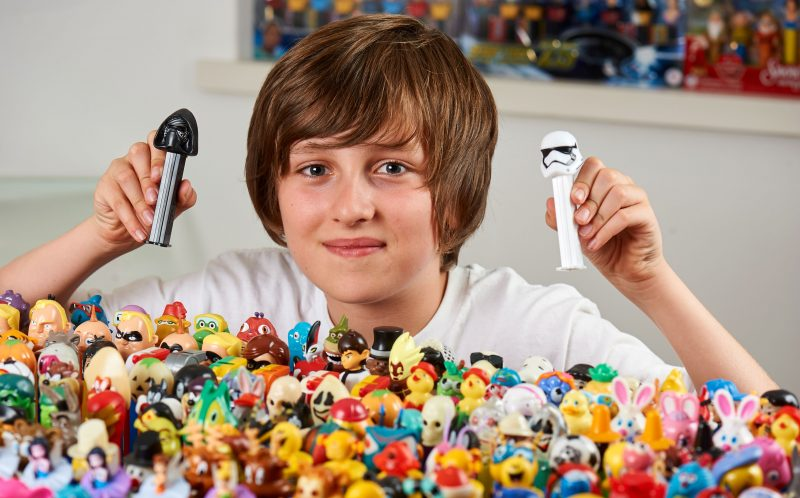 PIC BY MERCURY PRESS (PICTURED: ARCHIE MIDGLEY, 11, WITH THE HUGE PEZ COLLECTION)A Pez collector who has a collection worth 30,000 has travelled around the world because of his love of the sweet dispensers. David Midgley has more than 3,000 of the quirky childrens toys and has travelled to conventions in the United States as well as to Pezs country of origin in Austria. The 46-year-old property developer, from Mill Hill, north London, whisked his wife Beverley, 45, away to Vienna for a surprise weekend away - only to drag her to a Pez convention in the city before heading to the factory where they have been produced since 1927. SEE MERCURY COPY