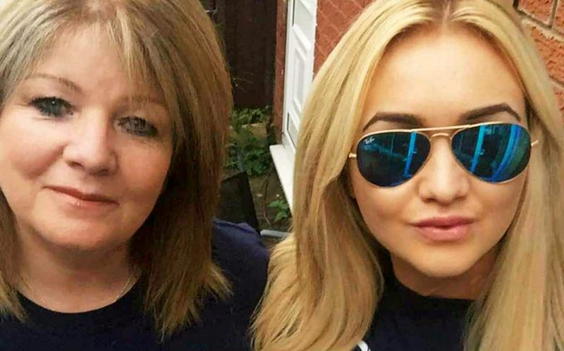 PIC FROM CATERS NEWS - (PICTURED: Bekkie and her mum.) - Paramedics feared a student who was millimetres from death had been DECAPITATED after a terrifying car crash. Bekkie Payne, from Wombourne, Staffordshire, is still on morphine 18 months on from the horror smash which put her in hospital for seven weeks. Bekkie, 23, was driving round a roundabout when her car clipped the kerb, sending her Fiat Punto crashing through a wooden fence into a ditch where it then set on fire. A fence panel severed her neck after coming through the windscreen and was just millimetres from a vital artery, with paramedics worrying she had been decapitated. The life-changing accident also left the criminology student with a brain injury, a paralysed left arm, a fractured collarbone, a chipped spine and heavy bruising to her face. SEE CATERS COPY.