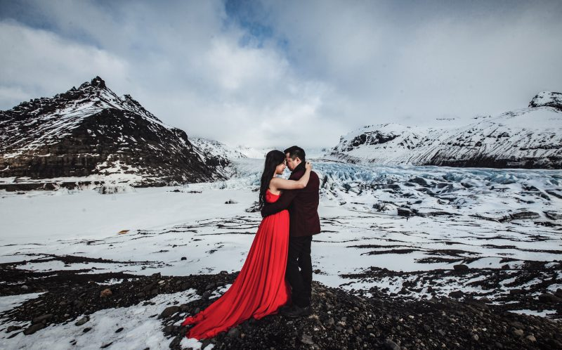 **PLEASE NOTE MANDATORY BYLINE** PIC BY LIFE STUDIOS / CATERS NEWS - (PICTURED: Cici and Clement pose in Iceland for their engagement photos.) - A loved-up couple announced their engagement with these brr-illiant photos - taken on a GLACIER. Cici Wu and Clement Ng jetted off to Iceland for the unique photoshoot, which also saw them pose on a volcano and next to a waterfall. The cool couple spent five days in the icy climes getting their perfect photograph after enlisting the help of cinematographer Jacob Wasef. Vancouver-based Jacob, Creative Director at Life Studios Inc, said it was an exhilarating but challenging shoot, with temperamental weather conditions and tricky locations pushing the couple to their limits. SEE CATERS COPY.