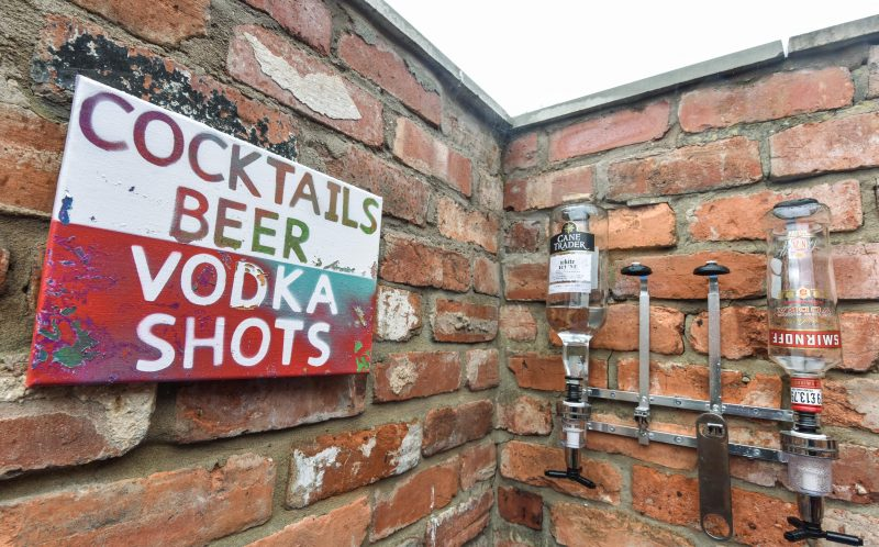 PIC BY MICHAEL SCOTT/CATERS NEWS - (PICTURED: Cocktails can be made if you dont want a beer.) - A party-mad student transformed his concrete yard into a BEER GARDEN - without telling his housemates. Henry Debenham, from Bawdeswell, Norfolk, spent the summer turning the disused patio into the ultimate party hub, complete with bar stools, astro turf and a BBQ. The 20-year-old, whos in his final year at Lincoln University, splurged 780 decking out the beer garden - including splashing 300 on alcohol. The International Business student surprised his six other housemates when they returned to their digs at the weekend, who absolutely love it. SEE CATERS COPY.