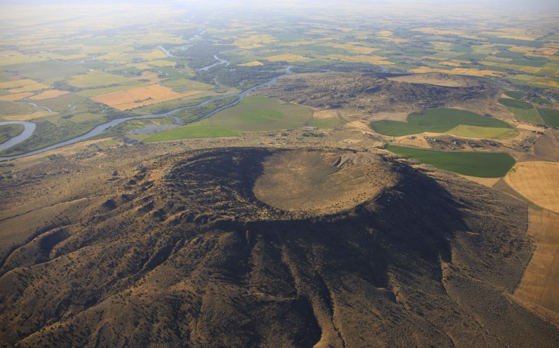 PIC BY JASSEN TODOROV / CATERS NEWS - (PICTURED: Volcanic vents, agricultural fields, and meandering river near Rexburg, Idaho. photographed from the air by Jassen Todorov.) - These stunning photographs show just some of the craters across America. The breathtaking pics - taken by Jassen Todorov - span six states including California, Washington and Idaho. Some craters are still active, like the Halemaumau Crater in Hawaii which even has a lava lake. The challenging project took Jassen, 40, over a year to complete - and involved several trips up and down America. The Professor of Music at San Francisco State University also visited Mt. Rainier in Washington - one of the most dangerous volcanoes in the WORLD - and a chain of craters and lava flows in Mono County, Eastern California. SEE CATERS COPY.