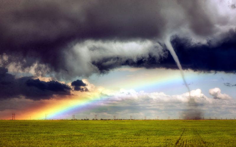 PIC BY JASON BLUM / CATERS NEWS - (Pictured: An amazing rainbow is present as the trunk of a tornado gathers dust cloud in Colorado,USA.) - These breathtaking pictures show the vast array of colours found all over the world. The stunning photos range from the purple rice fields of China to the beautiful night sky in the Russian countryside. The collection was brought together by a range of photographers who have all captured the images in the last five years. SEE CATERS COPY