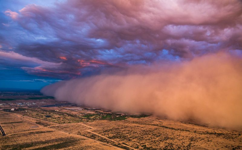 PIC BY CHOPPERGUY / CATERS NEWS - (PICTURED:Photos of the dust storm from the cock pit at sunset) - A pilot has shared aerial snaps of an epic dust storm swallowing up an entire city. Chief pilot at Chopperguy, Aron Whitesell, captured the dramatic images as he flew 1,000ft. over Phoenix, Arizona, USA. The brave pilot veered close to the ominous cloud as it rose as high as 5,000 feet in the sky on Monday (27th). SEE CATERS COPY