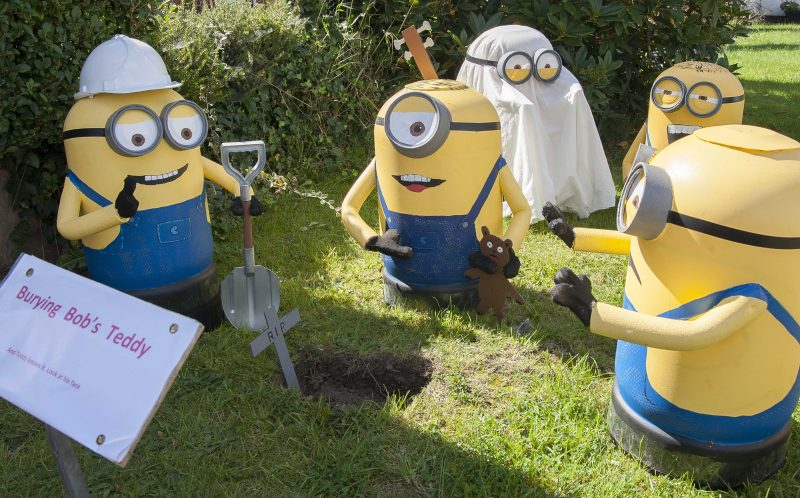 PIC FROM CATERS NEWS - (PICTURED: The Minions) - Forget Despicable Methis is DECIDUOUS Me! This minion-themed topiary train is causing a lo-comotion. The off-the-rails hedge design is the one time leaves on the track isnt a problem  and the train-shaped shrubbery has some unusual conductors. Jack Fisher, from Retford, Notts, first started trimming his overgrown bush nearly eight years ago - and since then his tired old hedge has transformed into a blossoming evergreen engine run by a team of MINIONS. The fun-loving 78-year-old cartoon enthusiast came up with the idea of creating the unique hedge after he became hooked on kids favourite Despicable Me. Retired hotel maintenance manager Jack, who has two children and seven grandchildren, said: In the past Ive worked as a cinema projectionist, so Ive got an interest in cartoon right through from Bambi to Wallace and Gromit, as well as the more modern ones. SEE CATERS COPY.