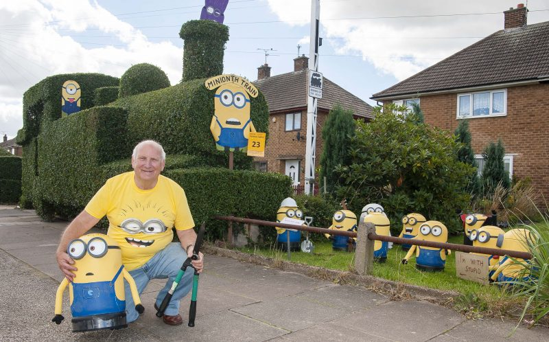 PIC FROM CATERS NEWS - (PICTURED: Charles Fisher with his Minions Train garden Hedge) - Forget Despicable Methis is DECIDUOUS Me! This minion-themed topiary train is causing a lo-comotion. The off-the-rails hedge design is the one time leaves on the track isnt a problem  and the train-shaped shrubbery has some unusual conductors. Jack Fisher, from Retford, Notts, first started trimming his overgrown bush nearly eight years ago - and since then his tired old hedge has transformed into a blossoming evergreen engine run by a team of MINIONS. The fun-loving 78-year-old cartoon enthusiast came up with the idea of creating the unique hedge after he became hooked on kids favourite Despicable Me. Retired hotel maintenance manager Jack, who has two children and seven grandchildren, said: In the past Ive worked as a cinema projectionist, so Ive got an interest in cartoon right through from Bambi to Wallace and Gromit, as well as the more modern ones. SEE CATERS COPY.