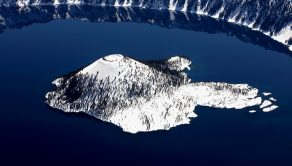 PIC BY JASSEN TODOROV / CATERS NEWS - (PICTURED: Crater Lake National Park, Oregon photographed from the air by Jassen Todorov.) - These stunning photographs show just some of the craters across America. The breathtaking pics - taken by Jassen Todorov - span six states including California, Washington and Idaho. Some craters are still active,  like the Halemaumau Crater in Hawaii which even has a lava lake. The challenging project took Jassen, 40, over a year to complete - and involved several trips up and down America. The Professor of Music at San Francisco State University also visited Mt. Rainier in Washington - one of the most dangerous volcanoes in the WORLD - and a chain of craters and lava flows in Mono County, Eastern California. SEE CATERS COPY.