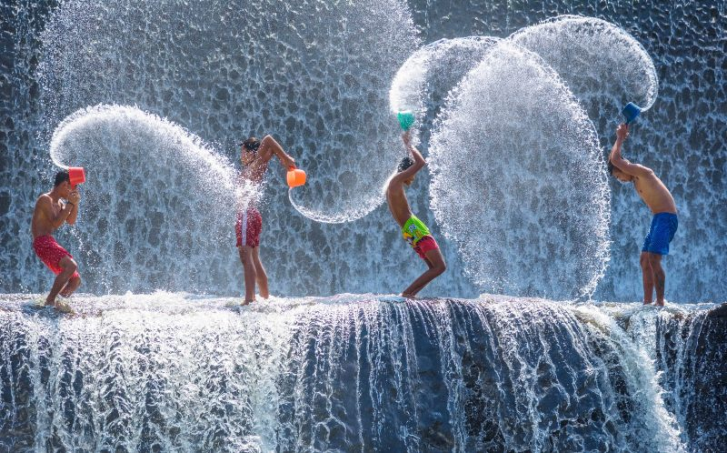 KIDS PLAY IN WATERFALL
