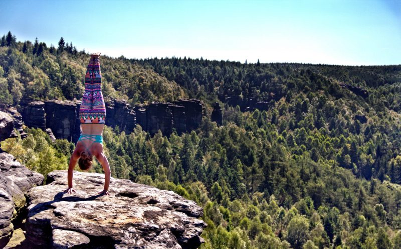 PIC BY LAETITIA GONNON/CATERS NEWS - (PICTURED: Laetitia Gonnon atop one of the sandstone towers in Ostrov, Czech Republic performing a handstand.) - A  brave climber has spoken of the moment she felt sand CRUMBLE in her palms as she scaled a rock. Laetitia Gonnon, from France, said it was very mentally challenging. To climb the sandstone towers in Ostrov, Czech Republic. The 24-year-old took the challenge on earlier this month having had a lot of experience in climbing. SEE CATERS COPY