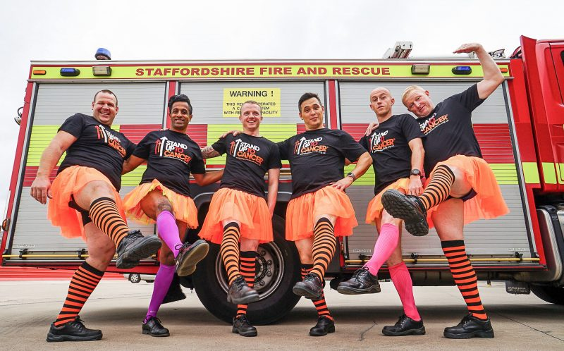 PIC BY STAND UP TO CANCER/CATERS NEWS - (PICTURED: Firefighters dress up in tutus for Stand Up To Cancer. (L-R) Lee Savage, Zie Khalifa, Lee Pine, Tim Chan, Jonathan Jackson and Watch Manager Chris Elkin in front of a Staffordshire fire engine.) - Staffordshire firefighters swapped boots for ballet gear in a tutu-daring video to raise money for Stand Up To Cancer. Members of Blue Watch from Hanley fire station switched their usual firefighting gear for short orange tutus and silly stockings in an act of clothing rebellion for Stand Up To Cancers stand out challenge. The cheeky firefighters took the challenge one step further when they showed off their best ballet moves to the well known Swan Lake classic - Dance of the Sugar Plum Fairy. Paula Young Cancer Research UKs spokesperson for Staffordshire, said: Wed like to thank the members of Blue Watch for going the extra mile and standing up to cancer in style. What better way to get our message across than to make people laugh?Stand Up To Cancer raises money to speed up breakthroughs from the lab to the patients who need them right now. With support, we can continue to fund vital research to get new and better treatments to cancer patients faster. Its time to join the rebellion against cancer. Stand up, stand out and help save lives. ENDS
