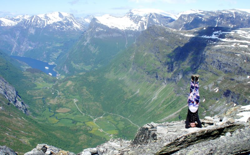 PIC BY AMY MALOON/CATERS NEWS - (PICTURED: Amy Maloon in Geiranger, Norway) - If this amazing video of yoga in the worlds most spectacular locations does not inspire you to become at one with nature- nothing will. Acupuncturist, Yoga Instructor, and an Intuitive Healer, Amy Maloon, 31, from San Francisco, CA, started practicing yoga as a teenager in an attempt to become more flexible for dancing. Amy filmed her yoga in 26 countries while working as an acupuncturist on a cruise ship and cannot wait to take her yoga retreats on a similar journey next year. SEE CATERS COPY.