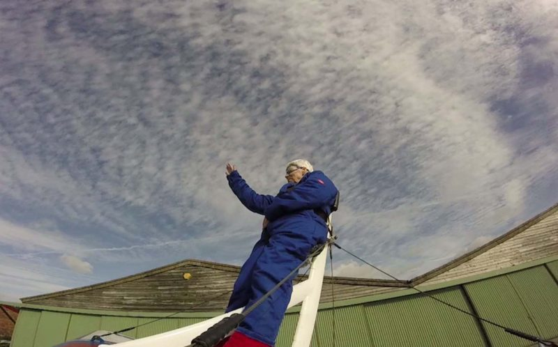 PIC FROM MERCURY PRESS - Gloria Lonyon, of Macclesfield, Cheshire, was strapped to the top of a biplane as it soared through the clouds.
