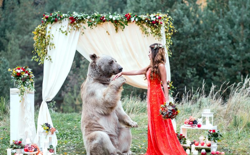 PIC BY OLGA BARANTSEVA / CATERS NEWS - Nelya gives her hand to Stepan the bear.