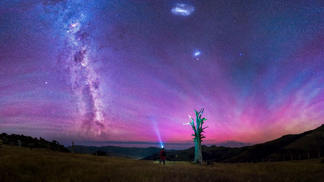 PIC BY PAUL WILSON/CATERS NEWS- (PICTURED: Paul Wilson takes a self portrait staring at The Milky Way over Banks Peninsula, New Zealand.) - Talk about a starry night! These mind-blowing images of stunning nightscapes will take your breath away. The incredible shots capture the true beauty of the nights sky, lit up in a kaleidoscope of colour, twinkling with millions of stars or adorned by the Milky Way. Paul, 29, is a wedding photographer by day but at night he pursues his passion for astrophotography. SEE CATERS COPY
