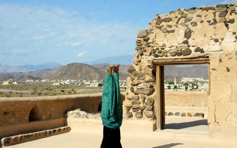 PIC BY AMY MALOON/CATERS NEWS - (PICTURED: Amy does a headstand in Muscat, Oman.) - If this amazing video of yoga in the worlds most spectacular locations does not inspire you to become at one with nature- nothing will. Acupuncturist, Yoga Instructor, and an Intuitive Healer, Amy Maloon, 31, from San Francisco, CA, started practicing yoga as a teenager in an attempt to become more flexible for dancing. Amy filmed her yoga in 26 countries while working as an acupuncturist on a cruise ship and cannot wait to take her yoga retreats on a similar journey next year. SEE CATERS COPY.