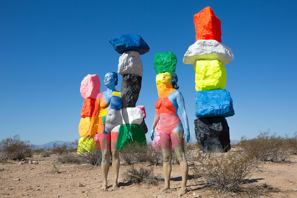 ***MANDATORY BYLINE*** PIC BY TRINA MERRY/CATERS NEWS (PICTURED: Two women blend into the colorful rocks at Seven Magic Mountains in Las Vegas, US) - A New York artist has used body paint to perfectly camouflage her subjects into a variety of famous landmarks. Trina Merry, who specialises in bodypainting, line her subjects up and photographed them as they appeared to blend right into the scenery around them. The backdrops to her eye-catching art include the White House, Freedom Tower, Grand Central Station, the Golden Gate Bridge, and even Irelands Giants Causeway. By painting her subjects into a modern background, Trina is putting a modern twist on the oldest art form known to man. SEE CATERS COPY