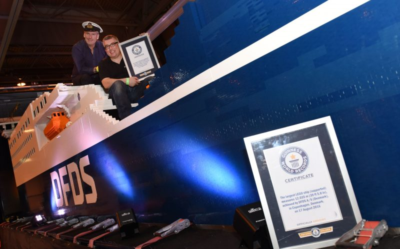 PIC BY KORAY EROL/ CATERS NEWS - Warren Elsmore and his colleague on the lego ship with their certificate.