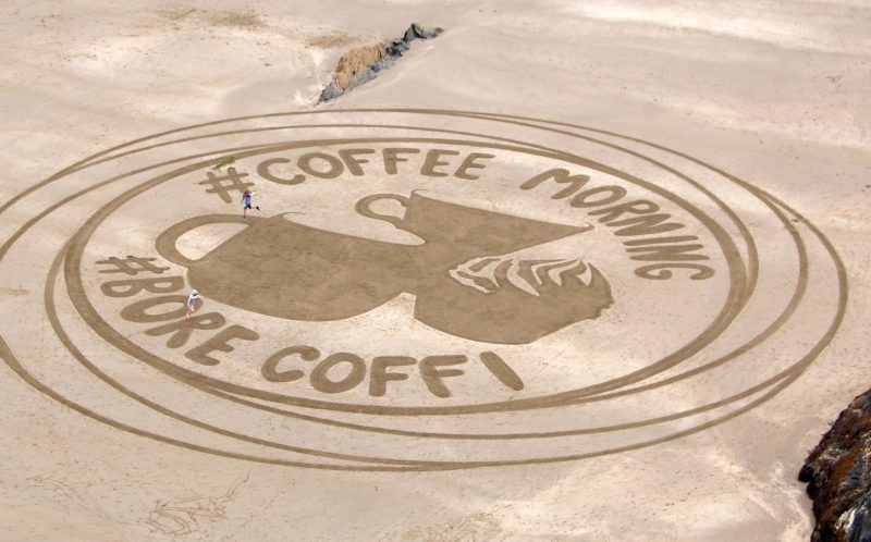 PIC BY MARC TREANOR/CATERS NEWS - Coffee themed piece of sand art made by Marc in Tenby.